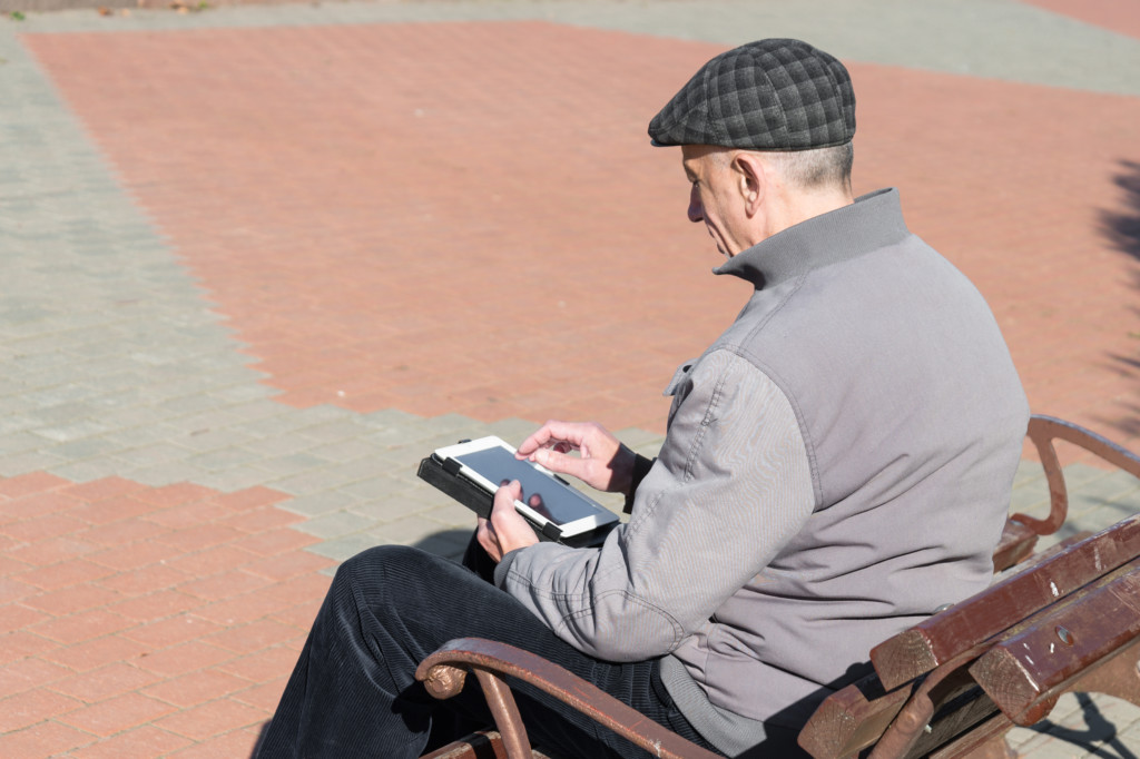 Old man on tablet