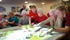 IT'S MAGIC. Residents and team members at Colten Care's Fernhill dementia care home in Longham, Dorset, try out the Tovertafel.