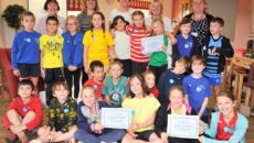 Eye Primary school children visit Hartismere Place as part of the Care Uk Dementia Awareness project.     Children being presented with their Dementia Friends awards