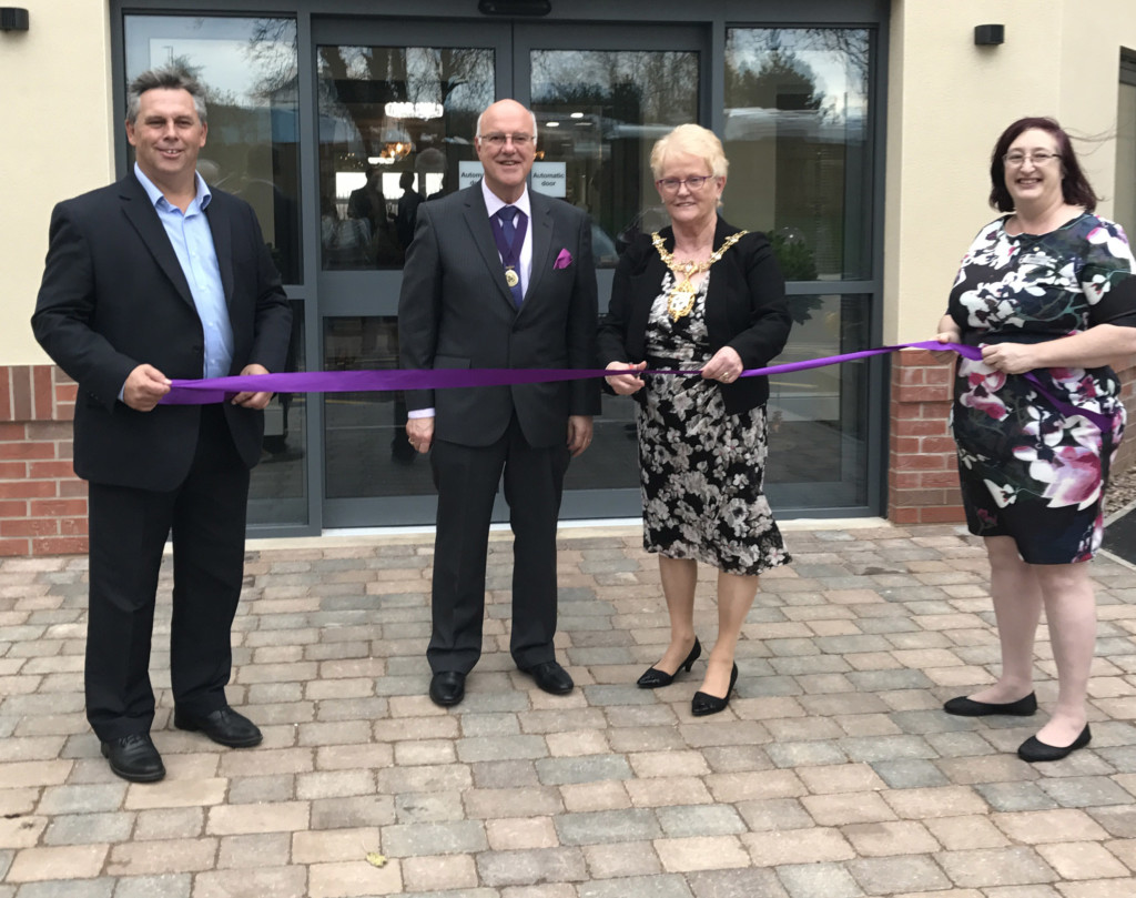 From left, Paul Farmer (Managing Director of Ideal Carehomes, Mr Trevor Ranson (Mayor's Consort), The Mayor of Charnwood Councillor Pauline Ranson, Sue Shaw (Home Manager for Mountview) cut the ribbon to officially open Mountview care home in Rothley