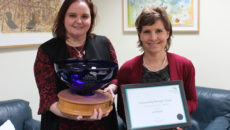 Liz (left) receives her award from Somerset Care CEO Jane Townson