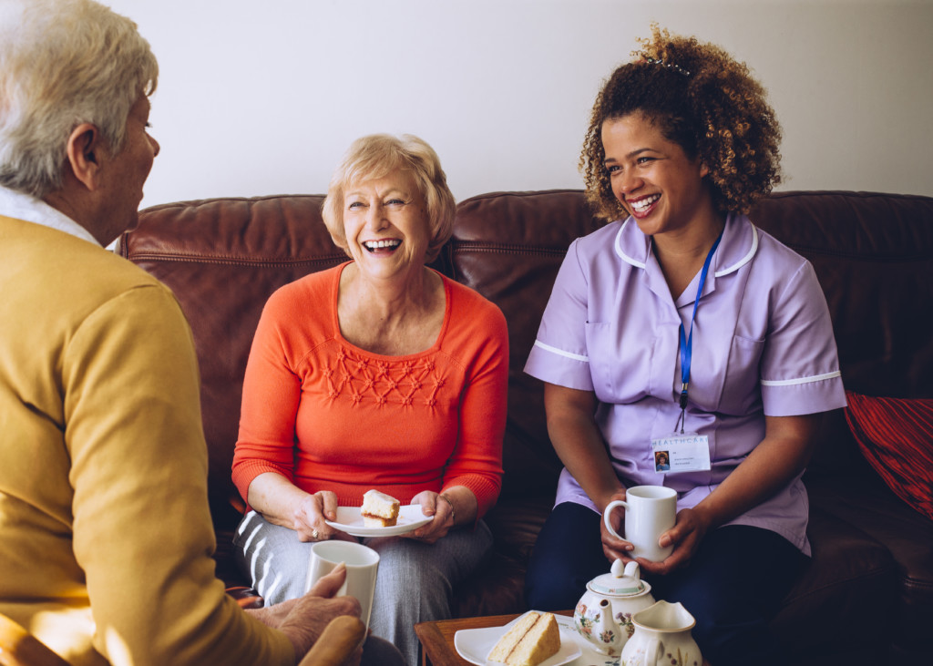 Caregiver Sharing Tea Time with her Patients