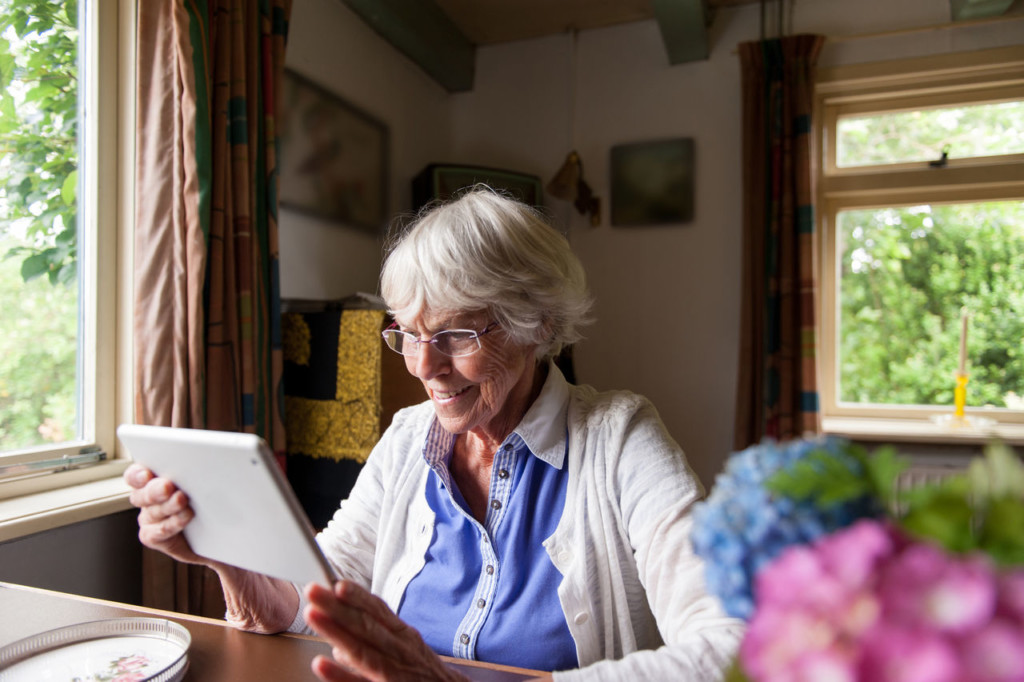 Bupa – older woman on tablet