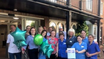 Colleagues at Bupa Queensmount celebrate their Outstanding report