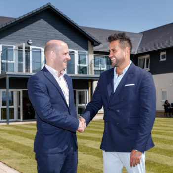 L-R Stuart Wardle and Paul Sokhi celebrate opening of Kingsacre Suites earlier in 2019, luxury care home in Duntocher outside Glasgow